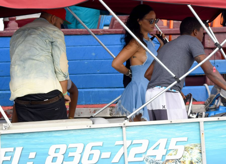 Rihanna in Blue Short Dress out in Barbados