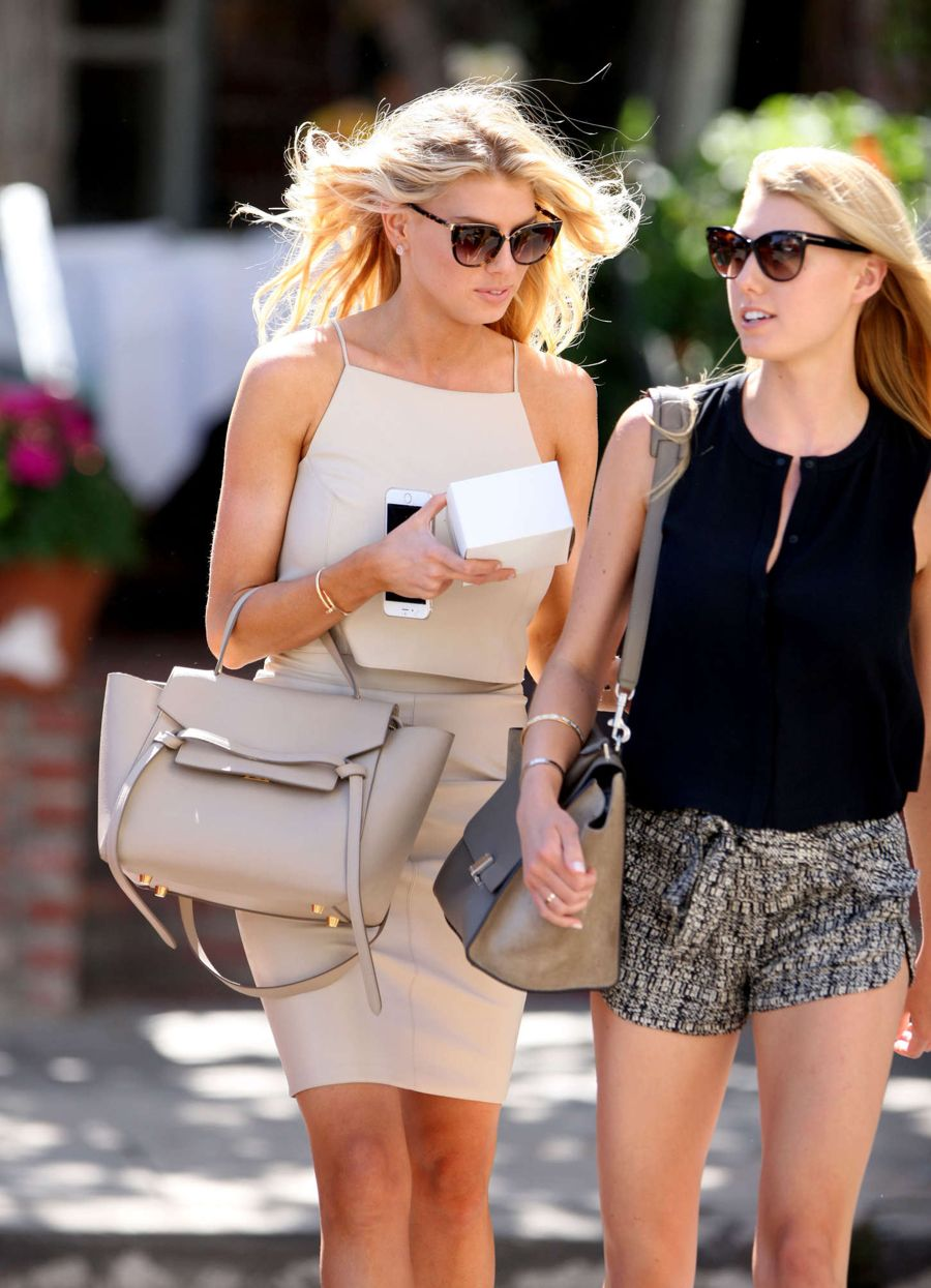 Charlotte McKinney Tries Clothing in Intermix Store