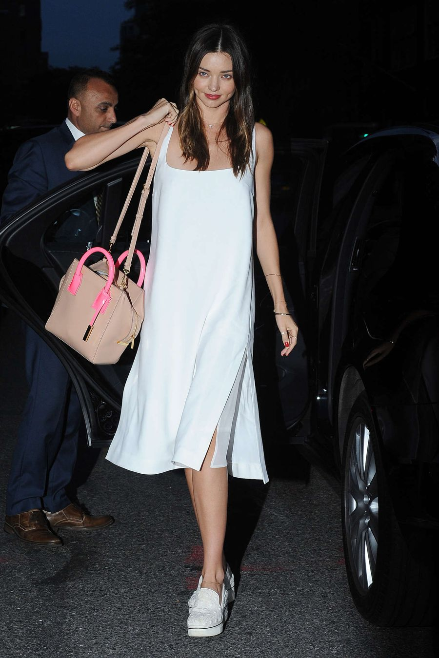 Miranda Kerr Comes Out in White Dress in Soho