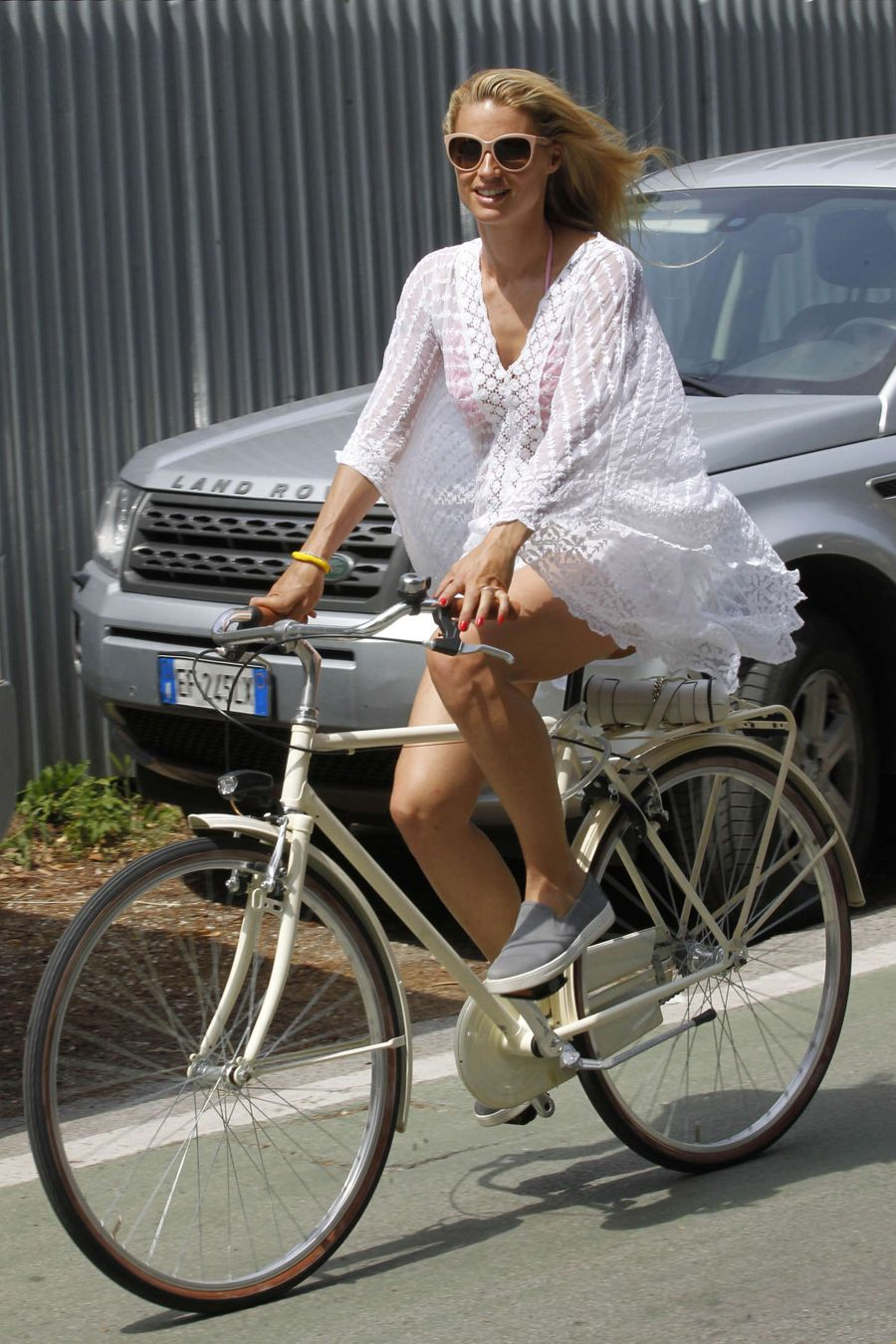 Michelle Hunziker - Riding a Bike in Italy