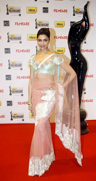 Deepika looks good in sheer and she knows it!