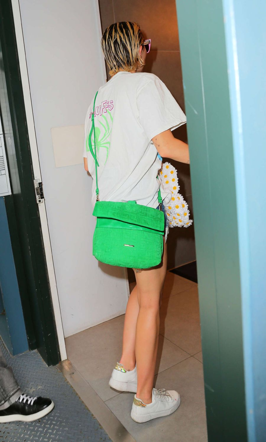 Miley Cyrus Stylish in Shades and Shorts in New York