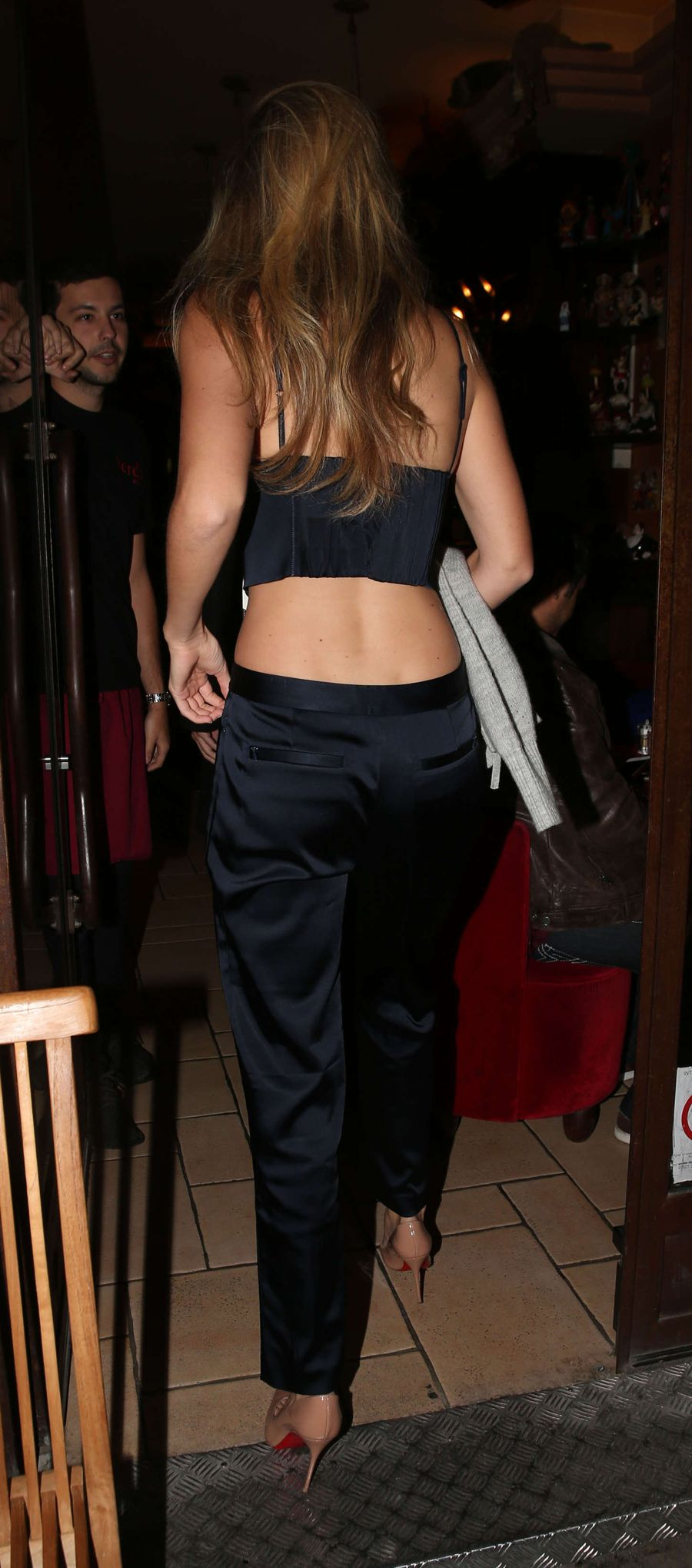 Gigi Hadid in Plunging Vest Top and Trousers in Paris