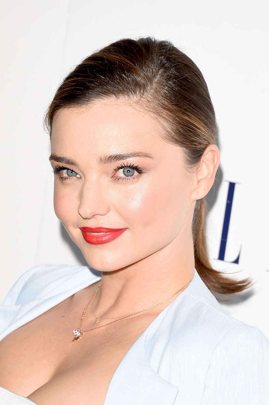 Miranda Kerr draws attention in a Bandage Crop Top