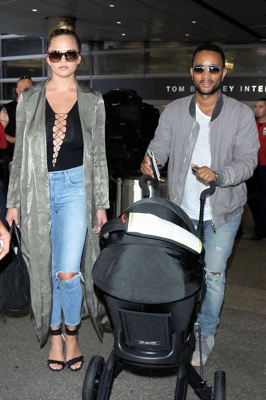 Chrissy Teigen in Jeans at LAX Airport in Los Angeles