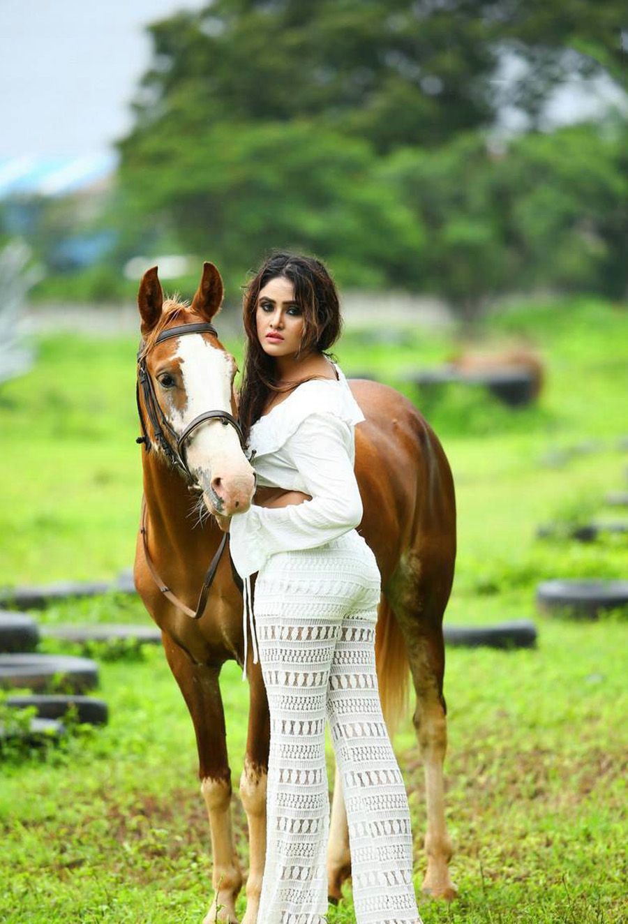 Sony Charishta Posing by the Horse