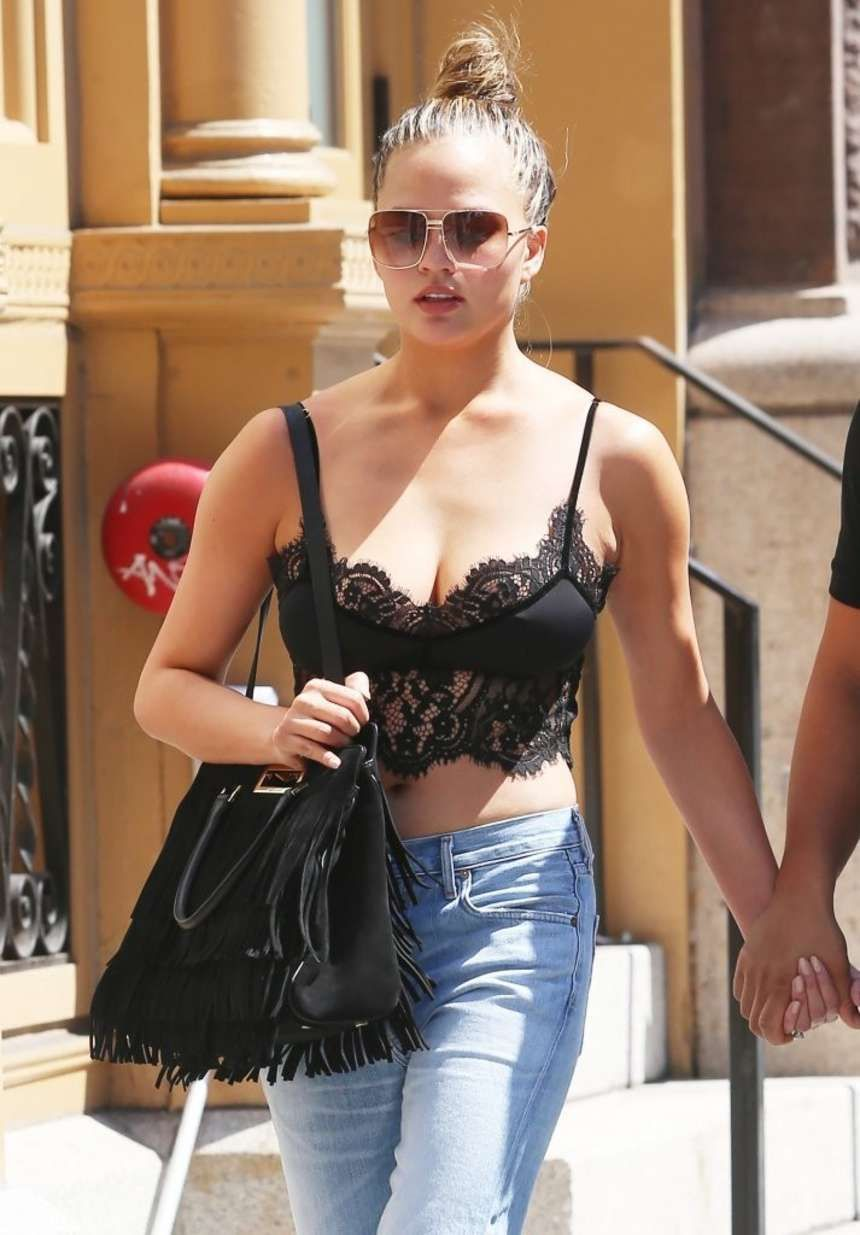 Chrissy Teigen - Wearing a Lace top out in NYC