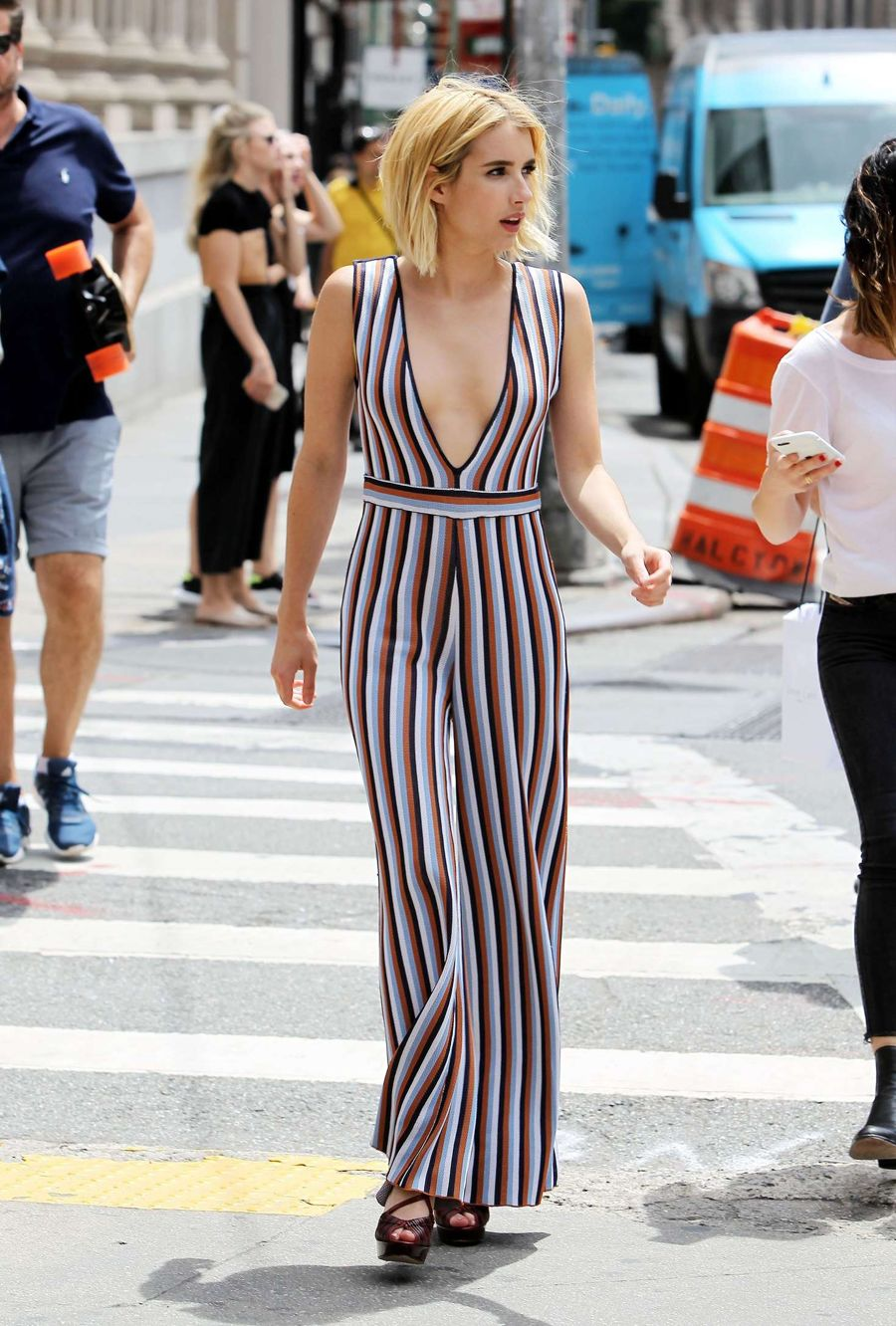 Emma Roberts Smolders in a Low-Cut Jumpsuit