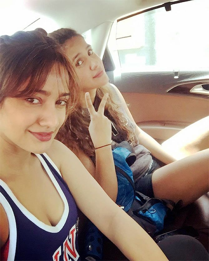 Young Aisha Sharma Poses in Sports Bra