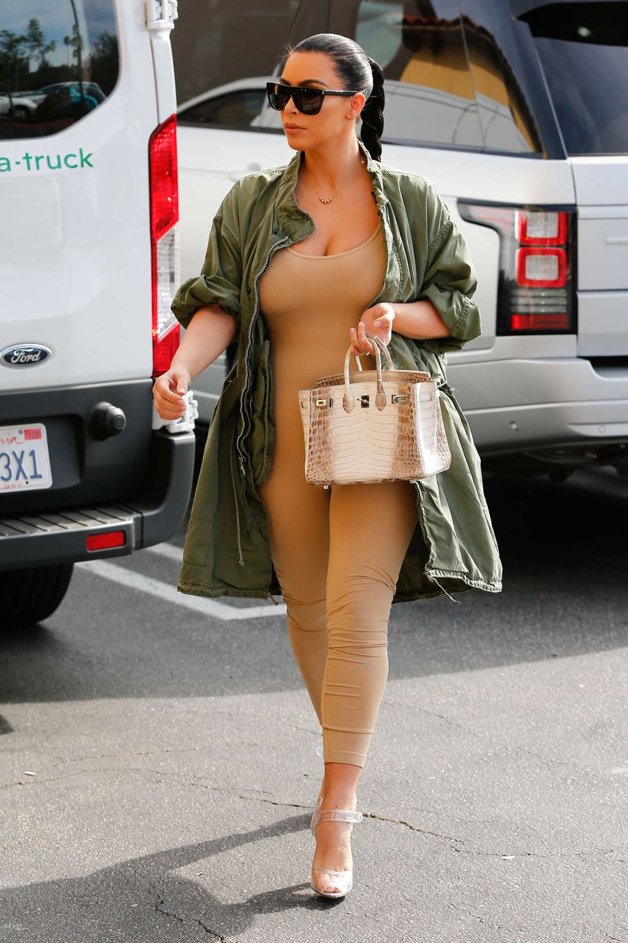 Kim Kardashian shows Post Baby Figure in Body Suit