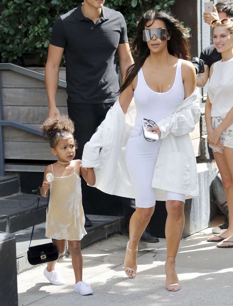 Kim Kardashian in White Leaving her apartment