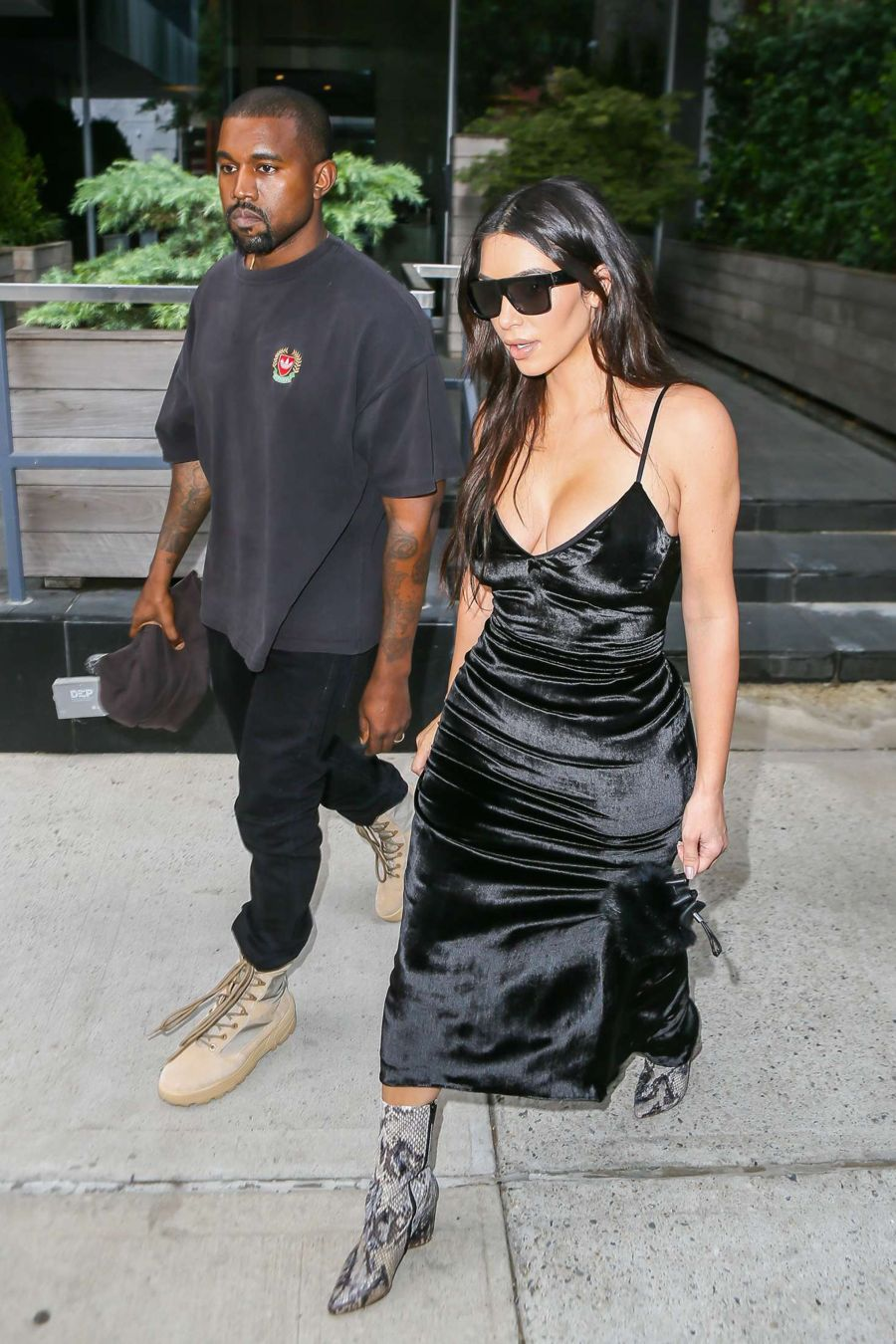 Kim Kardashian in Black Satin Dress at Kanye's Saint Pablo