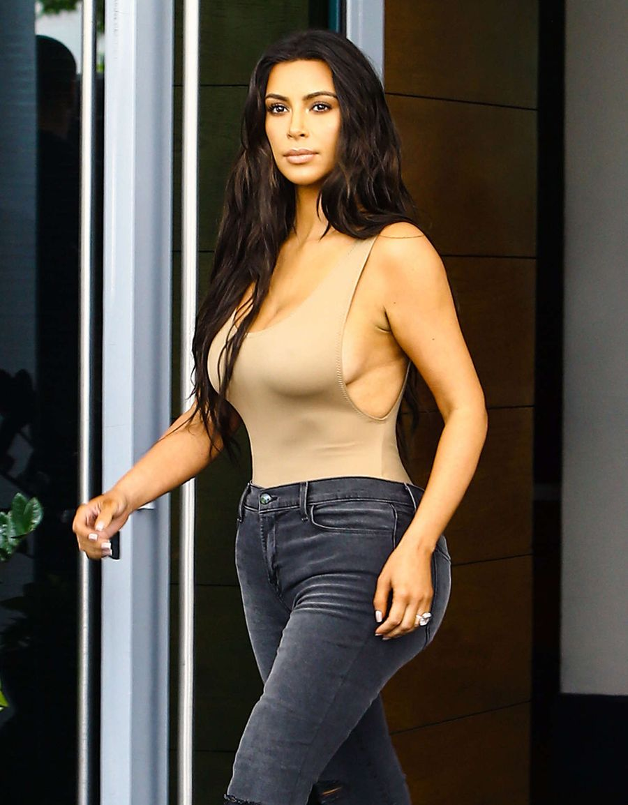 Kim Kardashian in Skin Colored Top and Jeans