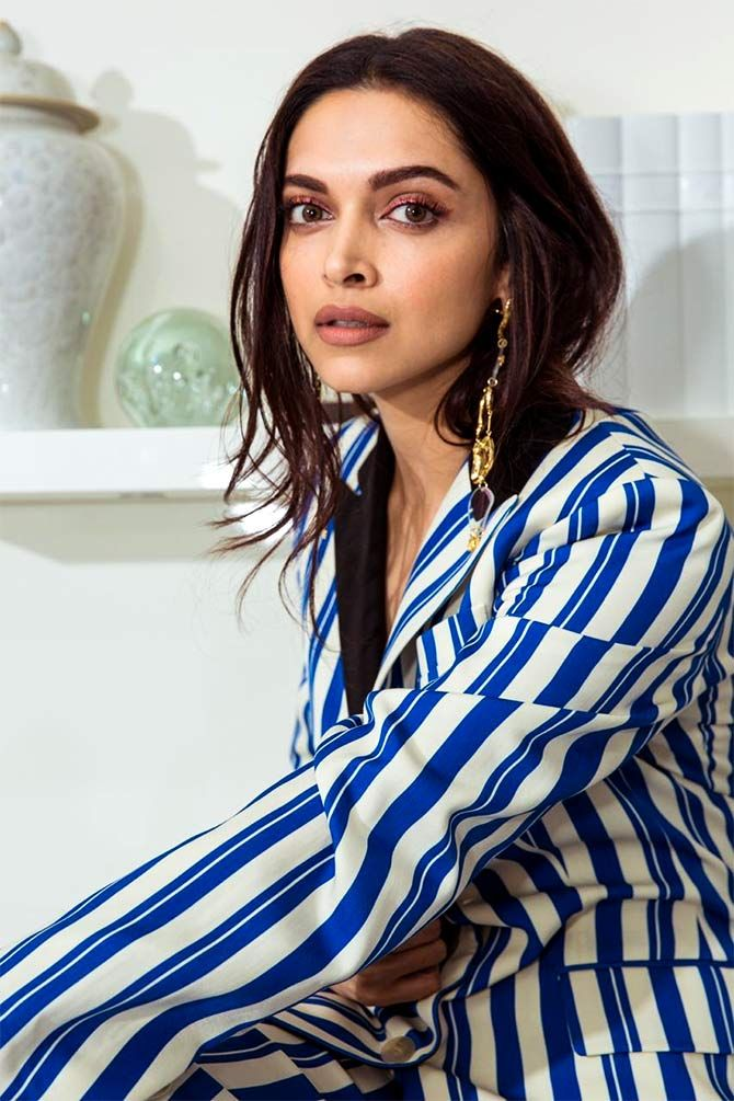Deepika Padukone in white-and-blue striped pant suit ...