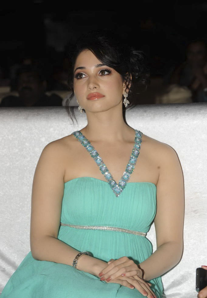 Tamanna sizzles in off shoulder dress in event