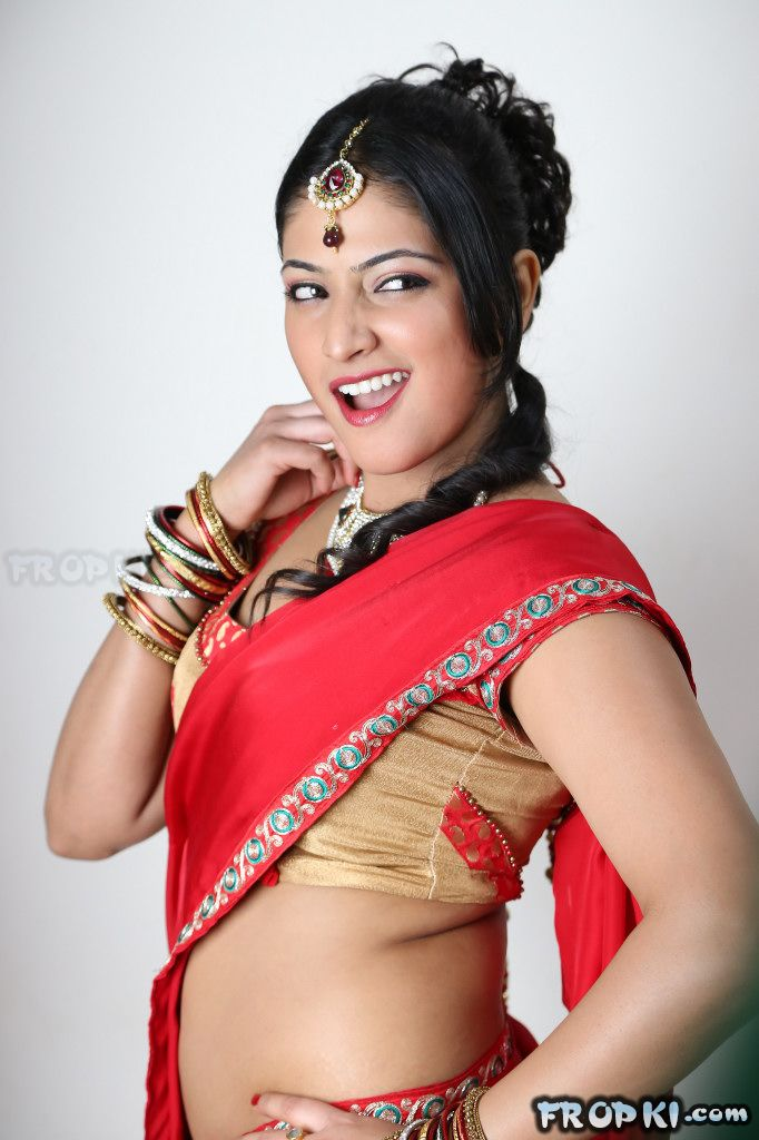 Haripriya Sizzles in Red Saree
