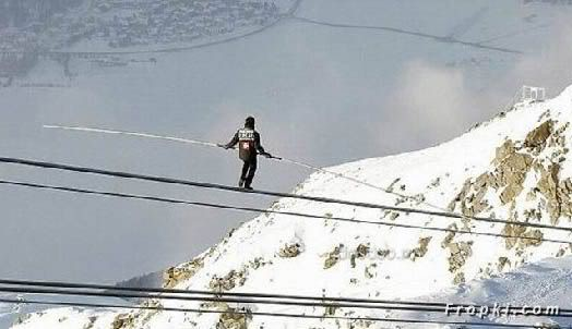 Crazy Acrobat Walks on Cable over Mountains