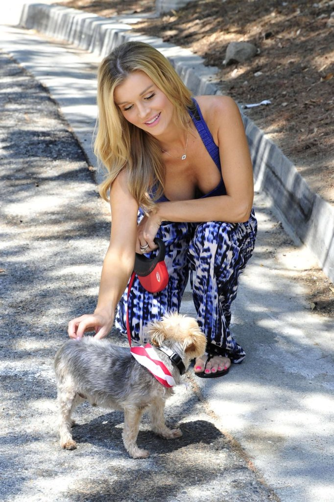 Joanna Krupa shows Taut Stomach and Sports Bra