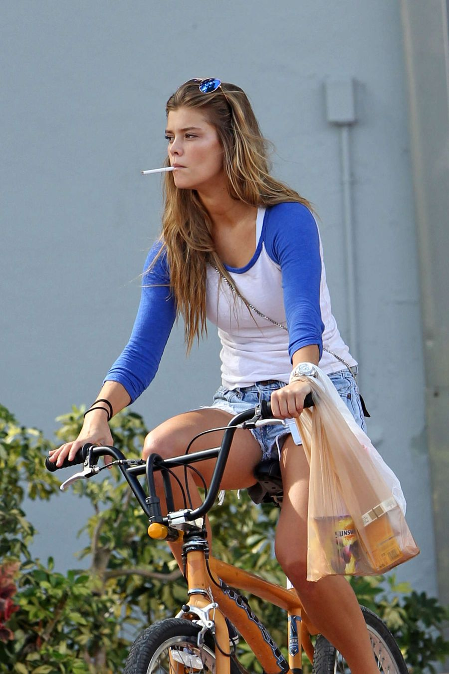Nina Agdal Rides her bike in Miami